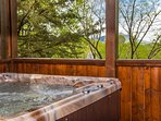 Enjoy a Bluff Mountain view from the hot tub.