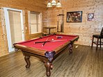 8 ft slate pool table with a door to the lower balcony