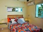 Master Bedroom (queen bed, a/c, ceiling fan, alarm clock)