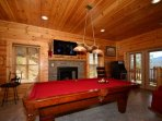 How about a pool tournament, pool room features access to balcony, Arcade games and wet bar.