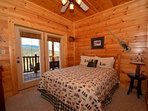 Lower level Queen Bedroom with Access to Balcony, Private Bath and Flat Screen TV