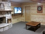TV Room with fireplace 55' TV Dish Network and DVD player
