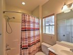 This shower/tub features a detachable hose and vibrant curtain that adds a pop of color!