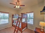This 4th bedroom also features twin-over-twin bunk beds with a twin-sized trundle.
