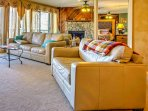 The living room area is complete with a gas fireplace, leather couches and a flat-screen cable TV for ultimate...