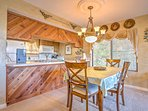 The dining room table makes for a wonderful place to enjoy the company of your travel companions and home made meals.