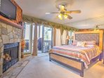 The master bedroom is complete with its own fireplace,  flat-screen cable TV, and full bathroom.