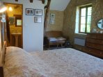 The main bedroom has a sofa as well as an ensuite shower and toilet.