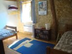 The third bedroom has two single beds and also overlooks the garden.