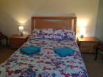 Double bedroom with bedside tables wardrobe and chester of drawers