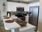 Full service kitchen; new stainless steel appliances.