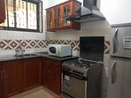 Kitchen: equipped with gas cooker, refrigerator, microwave, cooking and eating utensils.