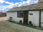 THE OLD STABLES, underfloor heating, off road parking, courtyard patio, in