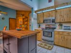 Our Kitchen has lots of counter space and a butcher block island. Room for the whole family to cook!