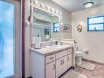 Bright and cheery Cabana Bath has full tub and shower. Baths have hair dryers.