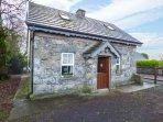STONE COTTAGE, detached stone cottage, multi-fuel stove, ample parking