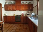 Well equipped kitchen with large separate utility room