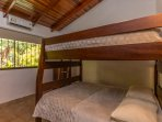 Bedroom two, queen bunk beds. All bedrooms and main areas have separate AC systems.