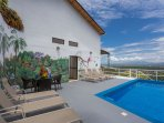 Private pool with spacious lounging area. Walls Mural painted by a local artist.