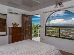 Bedroom four, lower level, access to house and pool deck.