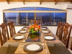 Dining room with the evening lights of Quepos below.