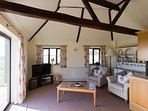 Antique timbers in the lounge plus a settee out of sight! Fabulous all round views & door onto patio