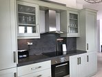 Handmade kitchen with Italian Corian worktop and integrated appliances...