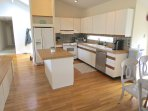 Fully equipped kitchen is open to the living area and patio beyond