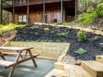 Lower patio is a great place to enjoy the outdoors and sit by the fire pit.