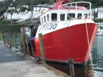 Looe - still a thriving fishing port. Enjoy fishing trips for mackeral or crab fish from the quay.