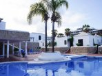 A beautiful pool which has a separate children's pool. There are plenty of sun beds to relax on