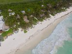 Aerial view of our Tulum Beach Homes property and the beach.
