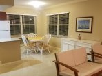 Dining area off of living room. Windows overlook the canal.