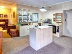 Open plan kitchen with gas hob and electric oven. Scullery next door with all amenities.
