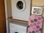 Utility room with freezer, washing machine and dryer