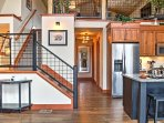 Walk upstairs to get to the cozy loft area, complete with comfortable leather furnishings and a flat screen cable TV.