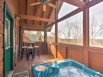 Relax and recharge at this Pigeon Forge vacation rental cabin with a private hot tub!