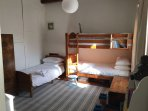 Bunk room with third bed