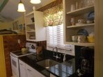 Remodeled antique kitchen with black granite counter tops