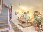 Enter this home into the formal living and dining area, adorned with high-end, stylish decor.
