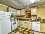 Prepare a tasty treat in this fully stocked kitchen, complete with a coffee maker and crock pot.