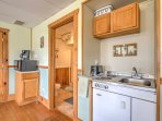 Prepare meals and snacks in this kitchenette with sink, toaster, stove top, and mini fridge.
