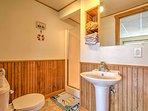 Wash off from the day in this bathroom with walk-in shower.