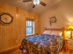 When you're ready for bed, retreat to this bedroom with a queen-sized bed.