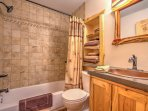 Get ready for bed in this full bathroom with shower/tub.