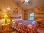 Fall fast asleep on this full-sized bed with cozy bedding.