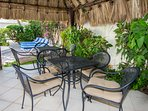 South palapa patio has two tables and chairs plus a built-in BBQ