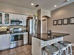 The kitchen features granite counters, stainless appliances, and new cabinetry