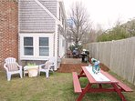 The back patio offers a picnic table and gas grill- 15 Oyster Drive Chatham Cape Cod New England Vacation Rentals