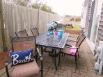 Another dining set is located on the patio with easy access to the kitchen through the sliders - 15 Oyster Drive...